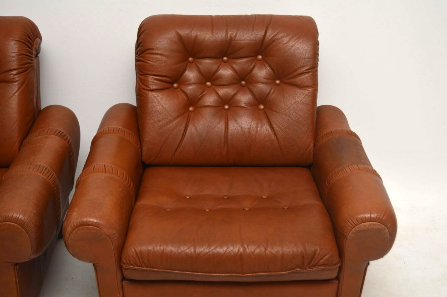 pair of danish vintage leather armchairs