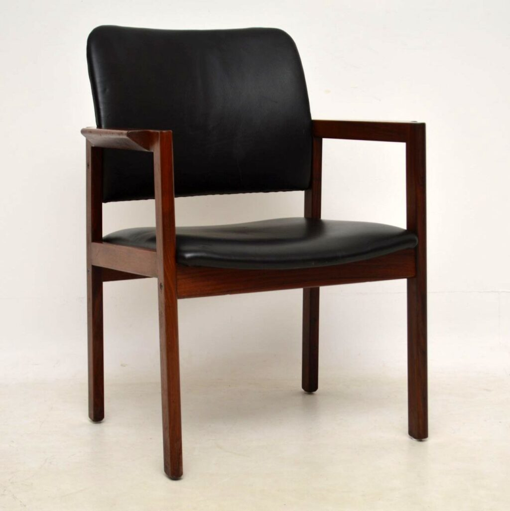 pair of rosewood and leather danish armchairs