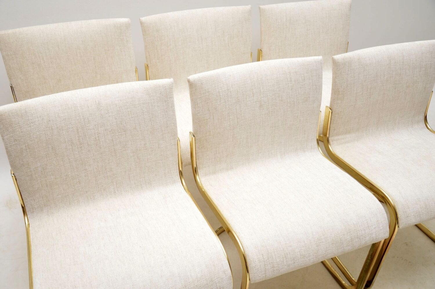 set of six italian brass cantilever dining chairs
