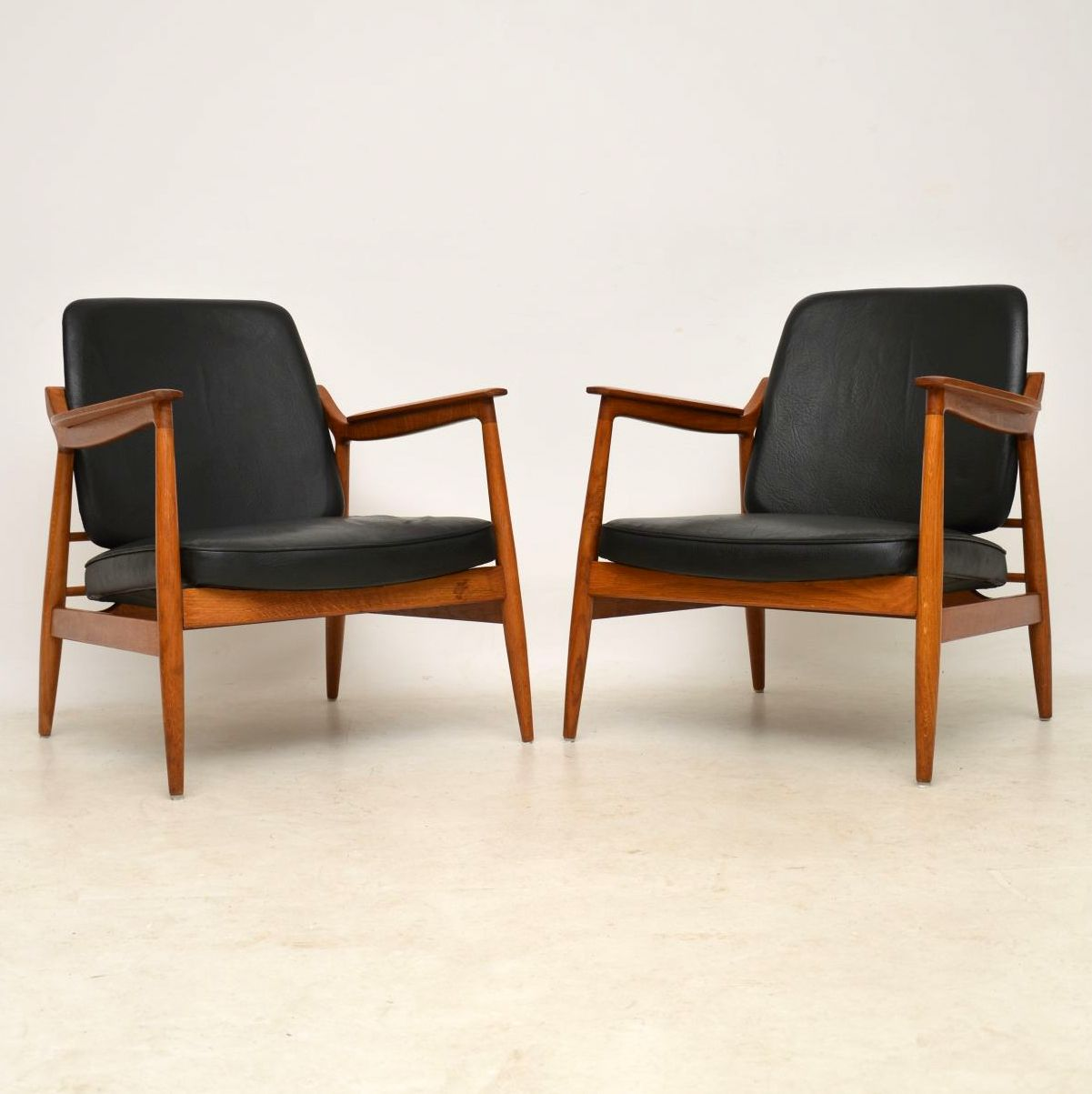 1960 S Pair Of Oak And Leather Danish Armchairs