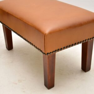 pair of antique vintage leather foot stools