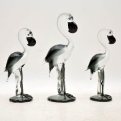 set of three glass art flamingo sculptures