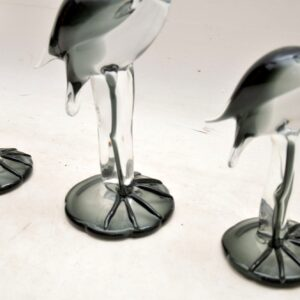 set of three glass art flamingo sculptures