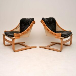pair of retro vintage danish leather armchairs