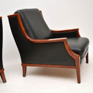 pair of danish retro vintage leather armchairs