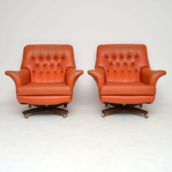 pair of vintage retro swivel armchairs by g- plan