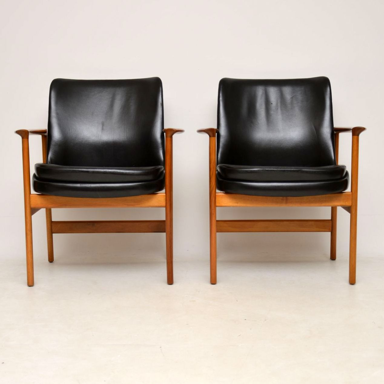 pair of danish leather walnut armchairs ib kofod larsen