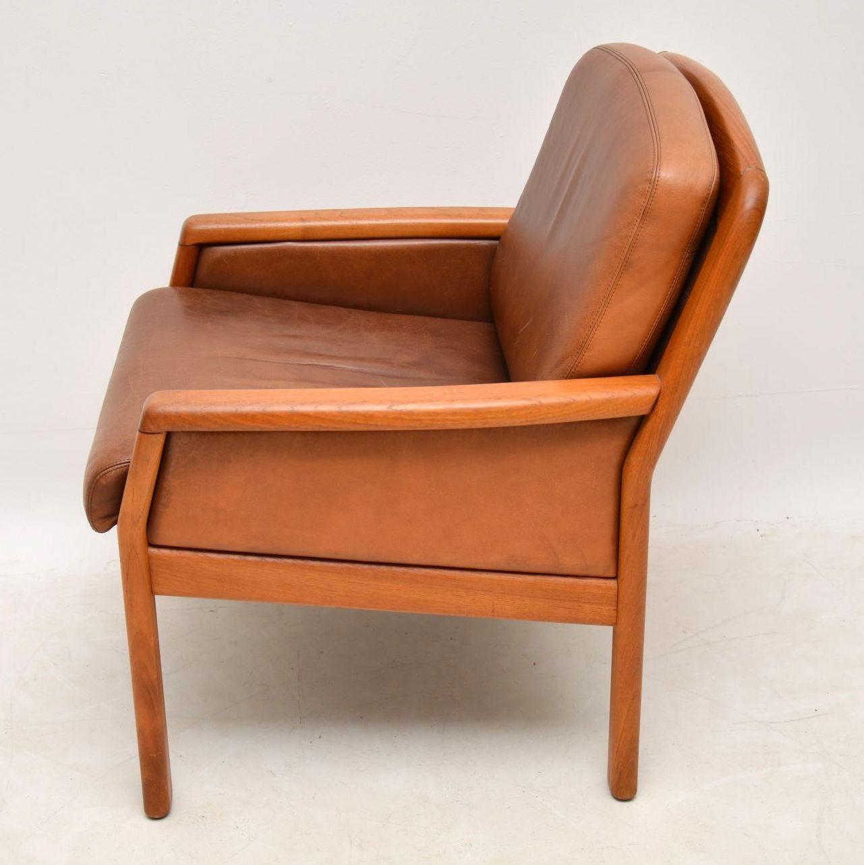 pair_of_danish_teak_leather_armchairs_10