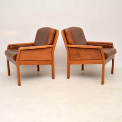 pair of vintage retro danish teak leather armchairs