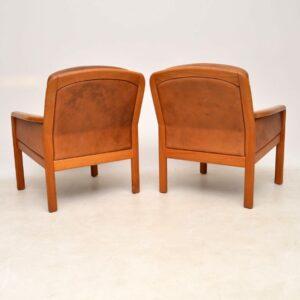 pair of vintage retro danish teak leather armchairs