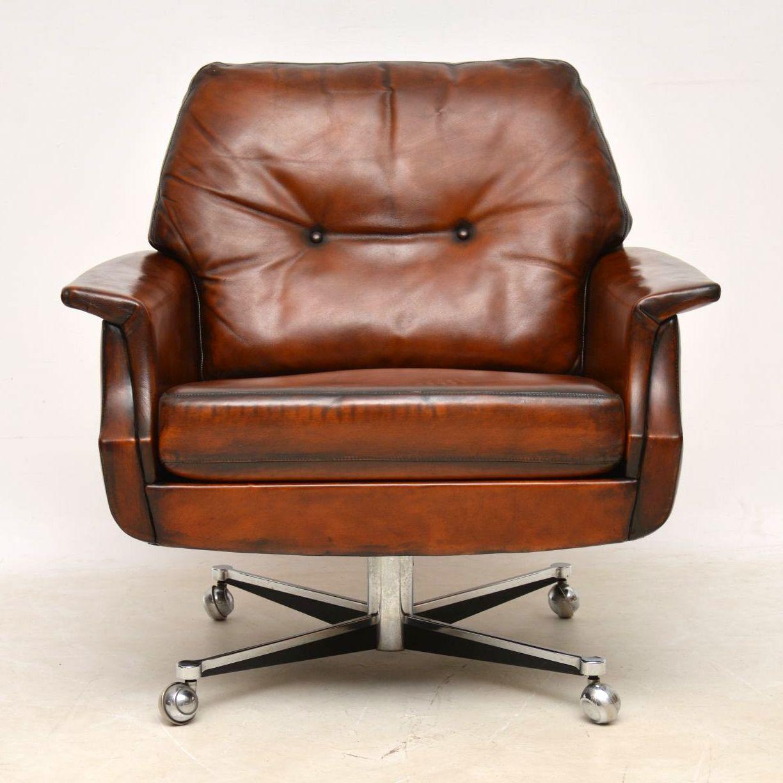 pair_danish_leather_chrome_swivel_armchairs8