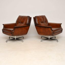 pair of retro vintage leather chrome swivel armchairs