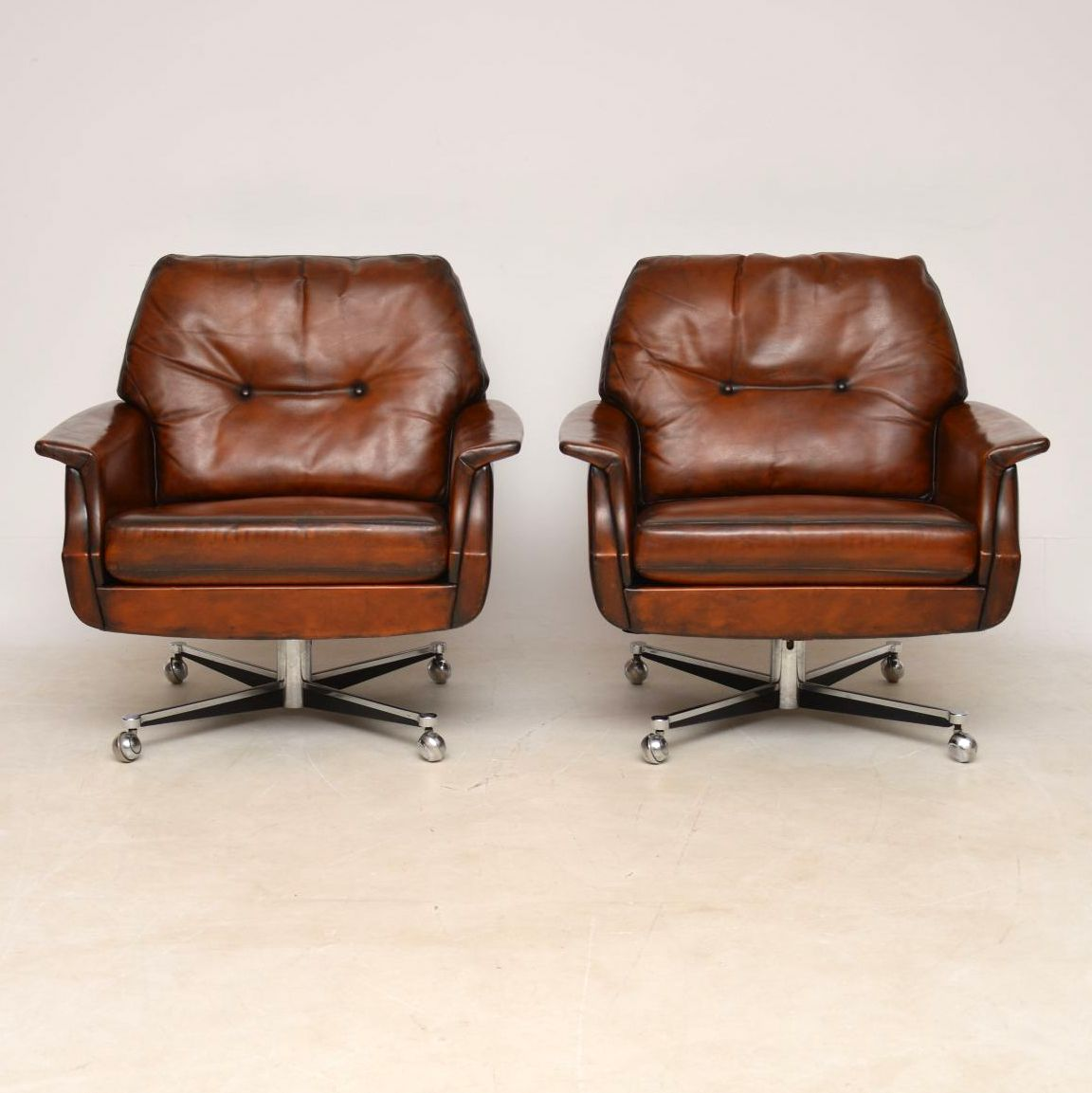 pair_danish_leather_chrome_swivel_armchairs_3