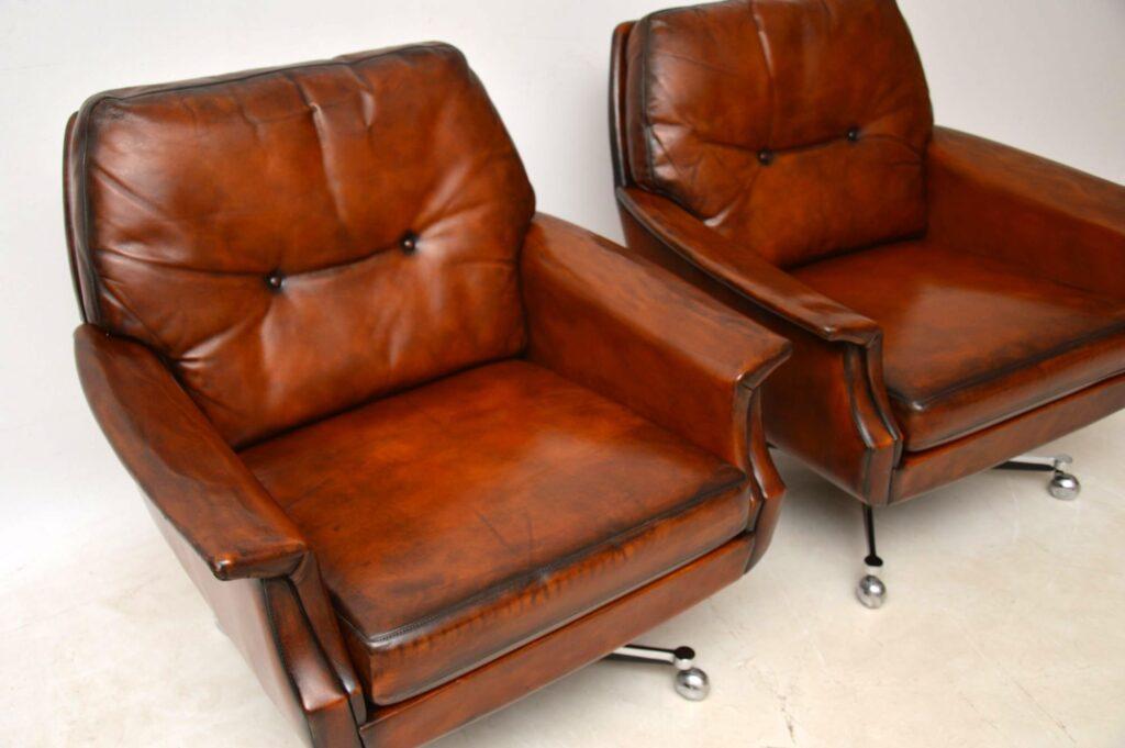 pair of retro vintage leather chrome swivel armchairs