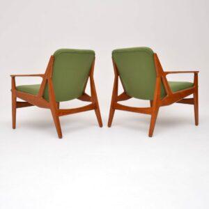 pair of danish retro vintage teak armchairs by arne vodder