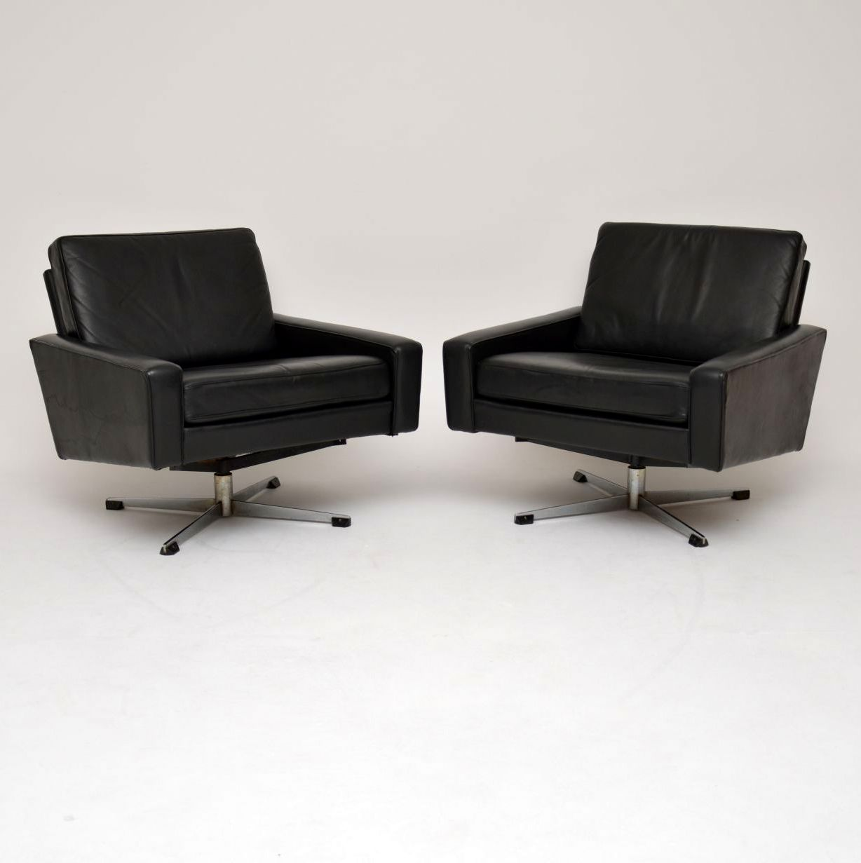 pair of danish retro vintage leather armchairs