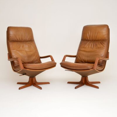 pair danish leather swivel reclining armchairs