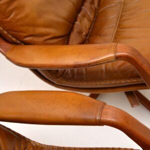 pair danish leather swivel reclining armchairs