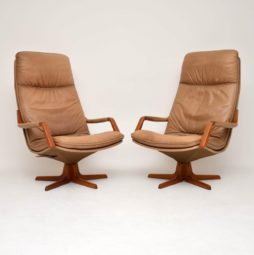 pair of danish leather teak reclining swivel armchairs by berg