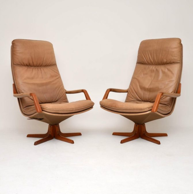 pair of danish leather teak reclining swivel armchairs by berg