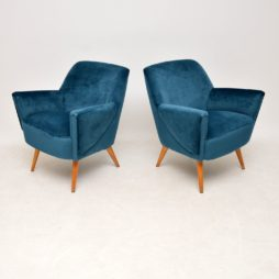 pair of vintage retro cocktail armchairs