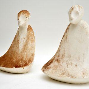 pair of retro vintage antique clay stone sculpture sculptures