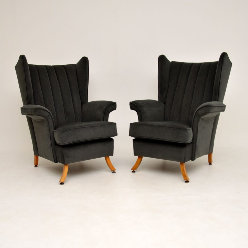 pair of retro vintage wing back velvet armchairs