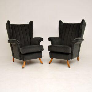 pair of retro vintage wing back velvet armchairs