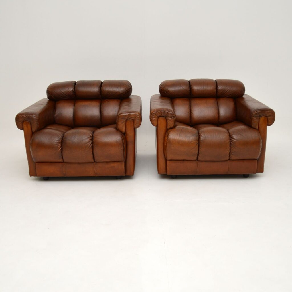pair of retro vintage leather club armchairs