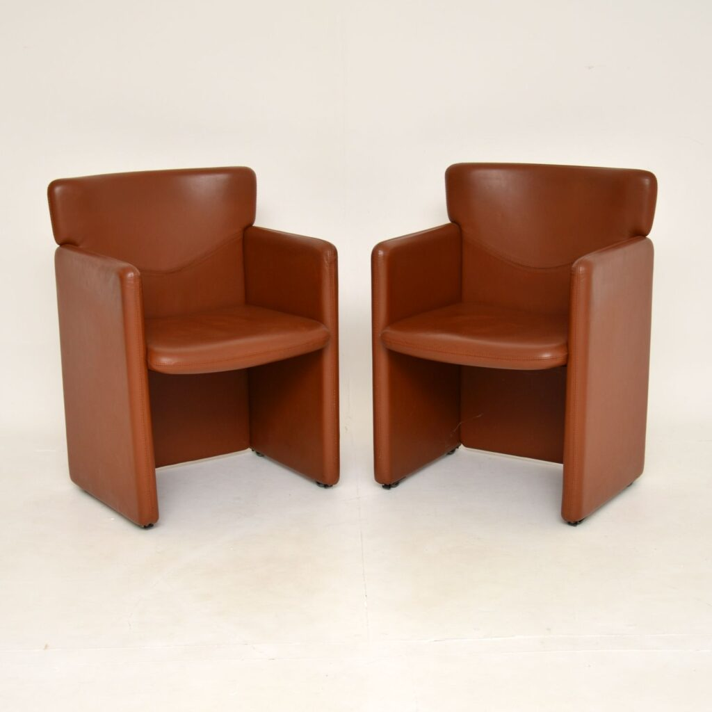 pair of retro vintage leather armchairs
