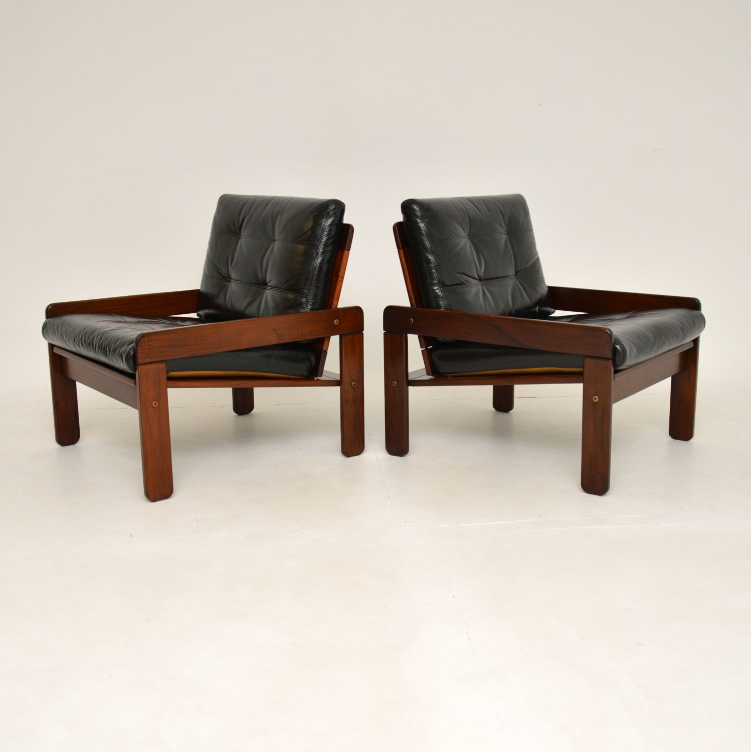 pair of retro vintage rosewood leather armchairs